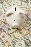Piggy bank on dollar bills Royalty Free Stock Photography