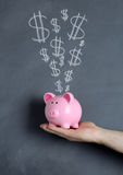 Piggy bank dollar explosion Royalty Free Stock Image