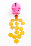Piggy bank and dollar sign. Pink piggy bank and dollar sign made from gold coins over white background royalty free stock images