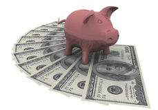 Piggy bank is on the dollars Stock Photography