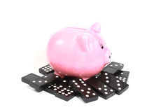 Piggy bank with dominoes Royalty Free Stock Images