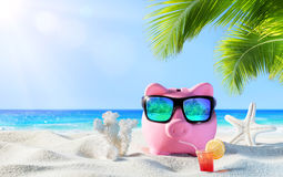 Piggy Bank With Drink. On The Palm Beach Stock Photography