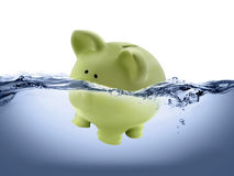 Piggy bank drown in water. Mean financial crisis Royalty Free Stock Images
