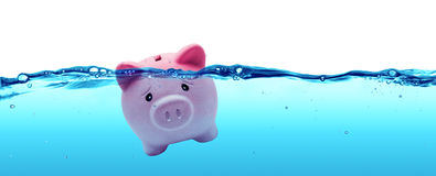 Piggy bank drowning in debt stock photography
