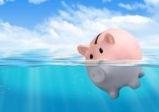Piggy bank drowning, savings loss concept. Piggy bank drowning at sea, savings loss concept royalty free stock photos