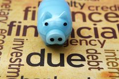 Piggy bank and due concept Royalty Free Stock Photography