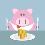 Piggy bank eating coin Stock Images
