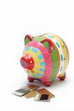Piggy bank eating credit 1 Stock Photo