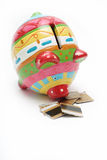 Piggy bank eating credit 2 Royalty Free Stock Photos