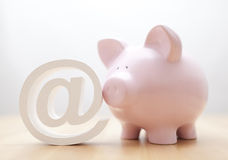 Piggy bank with email symbol Stock Photo