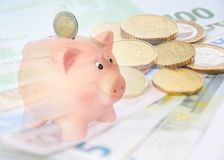 Piggy bank with euro background. Piggy bank with a euro background Royalty Free Stock Photos