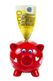 Piggy bank and 200 euro banknote Stock Image