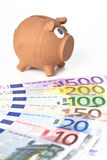 Piggy bank with euro banknotes Stock Photography