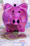Piggy Bank with Euro banknotes and coins Royalty Free Stock Photo
