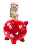 Piggy bank and 50 euro banknotes Royalty Free Stock Photo