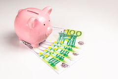 Piggy bank and euro bills royalty free stock photography
