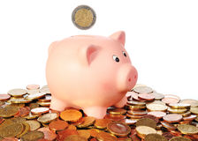 Piggy bank with 2 Euro Coin in a area from Euro Coins Stock Images
