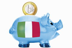 Piggy bank with 1 euro coin and italian flag Royalty Free Stock Photo