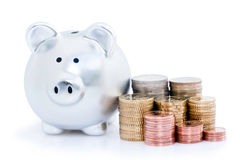 Piggy bank and Euro coins Royalty Free Stock Images