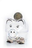 Piggy bank, coins and euro bills. Money saving concept. Banknotes closeup Royalty Free Stock Image