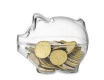Piggy bank with euro coins. Side view of transparent piggy bank with euro coins  on white Stock Image
