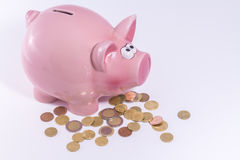 Piggy bank with euro coins Stock Photo