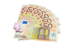 Piggy Bank on Euro Isolated on white Stock Photos