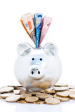 Piggy bank and Euro money Stock Photos