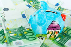 Piggy bank on euro money Stock Photos