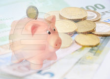 Piggy bank with euro symbol and euro background Royalty Free Stock Photography