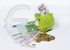 Piggy bank with euro symbol euro coin and bill Royalty Free Stock Photos