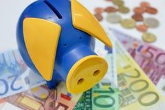 Piggy bank on Euros Royalty Free Stock Photos