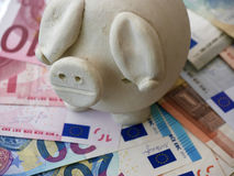 Piggy bank on Euros Royalty Free Stock Photos