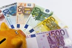 Piggy bank and Euros (EUR). Stock Photography