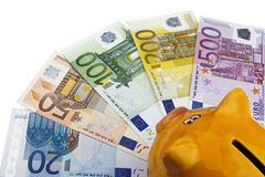 Piggy bank and Euros (EUR). Royalty Free Stock Photos
