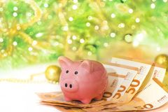 Piggy bank with euros on new year background royalty free stock photos