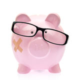 Piggy bank with eyeglasses Royalty Free Stock Photography