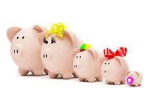 Piggy bank family Royalty Free Stock Image