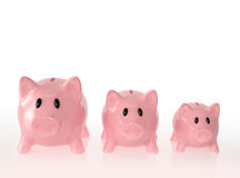 Piggy bank family with large, medium, and small size Royalty Free Stock Photos