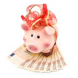 Piggy bank with festive bow Royalty Free Stock Image