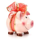 Piggy bank with festive bow isolated Royalty Free Stock Images