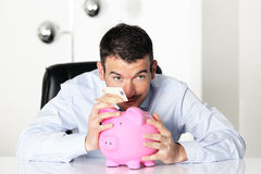 Piggy bank and fifty euro banknote Stock Photo