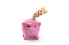 Piggy bank with fifty euro bill Royalty Free Stock Photo