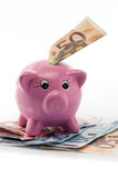 Piggy bank with fifty euro bill Royalty Free Stock Images