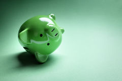 Piggy bank financial money problems. Piggy bank fallen over with financial money problems and copy space Stock Image