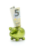 Piggy bank and five euro banknote Stock Photo