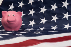 Piggy bank is on the flag Royalty Free Stock Photography