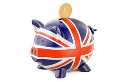 Piggy bank with flag of United Kingdom and golden pound sterling Royalty Free Stock Photos