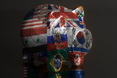 Piggy bank with Flags all countries of world. A black background royalty free stock images