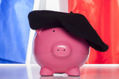 Piggy bank on a french flag Stock Images